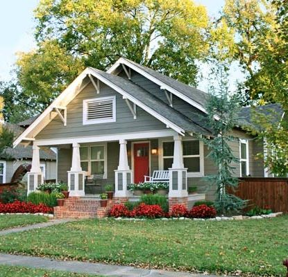 A drab 1920s house gets a Craftsman-style makeover with fiber-cement siding, a new porch with brick foundation fronts and beefy columns. See the Before here.