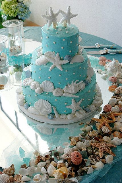 Wedding cake - aqua butter cream icing with starfish and shells
