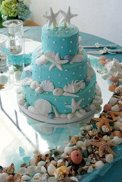 Wedding cake - aqua butter cream icing with starfish and shells
