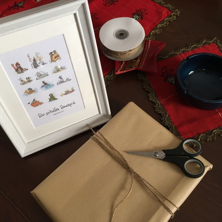 Preparing the Christmas gifts for my daughter's teachers using the printable dog calendar and some IKEA frames!!!!