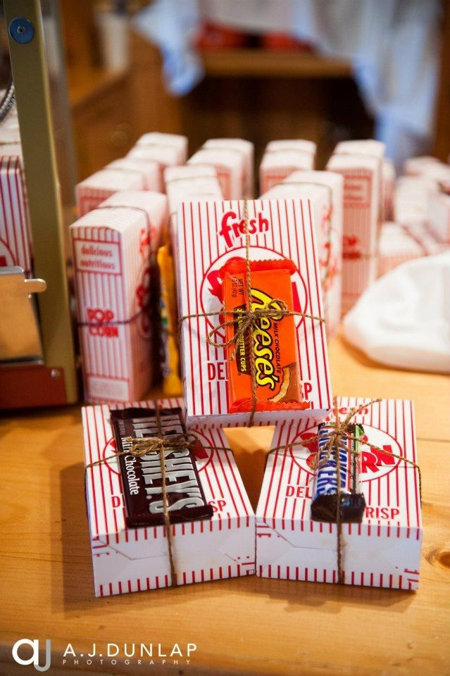 My husband and I met in high school when we both worked at a movie theatre. We handmade our favors to honor how we met. I ordered these 1ounce popcorn boxes online, we filled them with freshly popped movie theatre popcorn (from the movie theatre we met at), hot glued a variety of full-sized candy bar to each box and decorated each with twine. We secured each box closed with small round labeled with our name and wedding date designed through Vistaprint. They we aa huge hit with our guest!