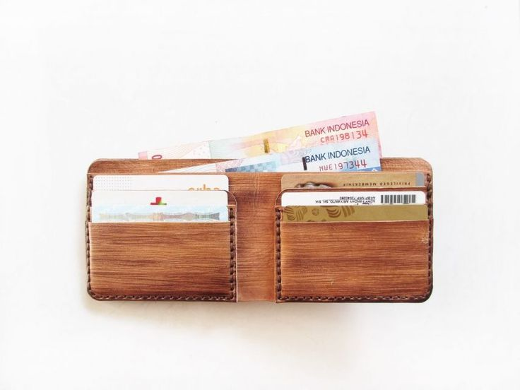 Bifold wallet with 2 money slots & 6 cards slots.  Made of genuine vegtan leather. It is 100% handmade. Every single part of the bag is hand-cut, hand-painted, hand-carved, and hand-sewn.  The wooden texture is hand-painted and hand-carved directly on leather surface.  Therefore, each product has a distinctive wooden texture and color to one another . It will slowly get darken over time due to exposure to the sun, make it more naturally beautiful.
