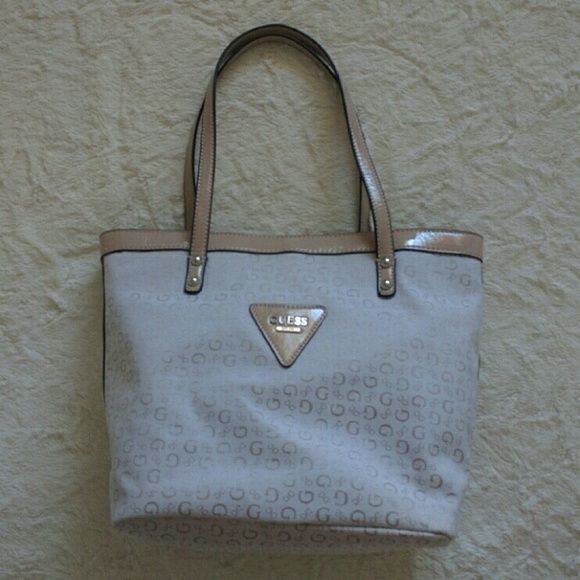 NWT Guess Shoulder Bag Either for office, school, or even a fashionable diaper bag... Very roomy ... And with flat straps, won't hurt your shoulder for a heavy carrying... Guess Bags Shoulder Bags