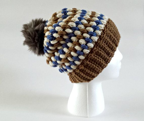 This beanie is a Knitting by Kali original design. It includes a ribbed brim, providing lots of stretch for a perfect fit. ◆ Hat made from: 100% acrylic yarn ◆ Pompom made from: 100% polyester ◆ Handwash, warm; Lay flat to dry ◆ Pompom Height: approx. 3 (7.6 cm) ◆ Hat Height: 9.5