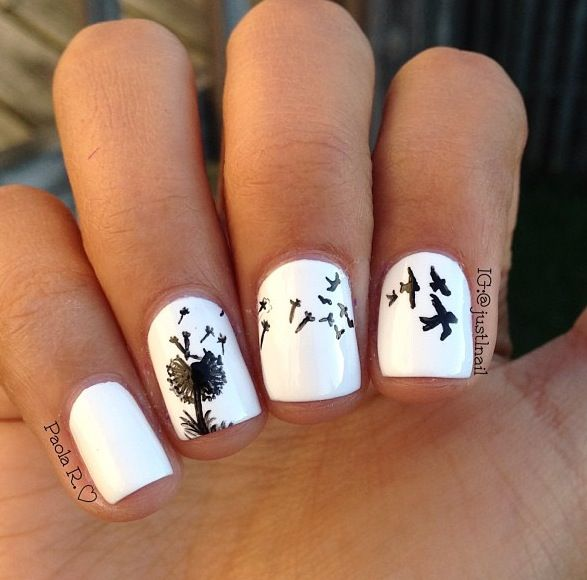 pretty nails with really small birds on