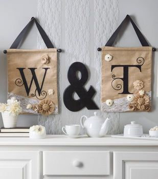 Embellished initial letters on burlap wall hangings