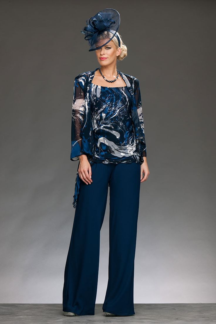 Full length chiffon trousers with an elegant wide leg. The top is embossed chiffon with a round neck and wide straps, and the jacket is matching fabric with padded shoulders and long drape hem. Product Code: 754/753 Colour: Navy Print