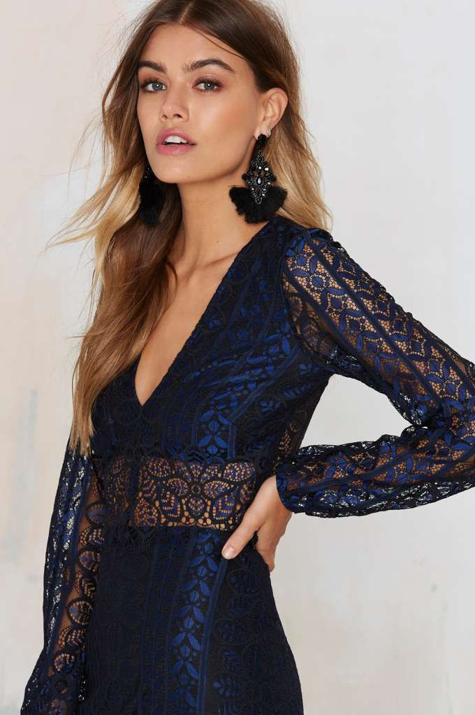 The Blue in the Lace top by For Love & Lemons is made in sheer blue and black lace and features an asymmetric fringe hem.