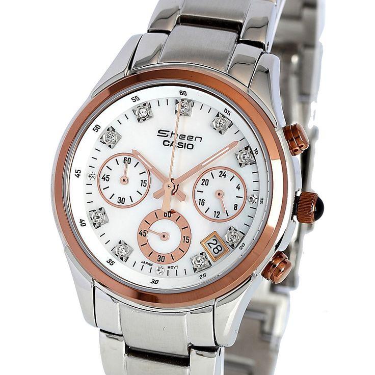 Elegante reloj de mujer de acero,esfera blanca,con 12 cristales SWAROVSKI y bonitos toques de cobre en agujas,pulsadores,bisel y esferitas.