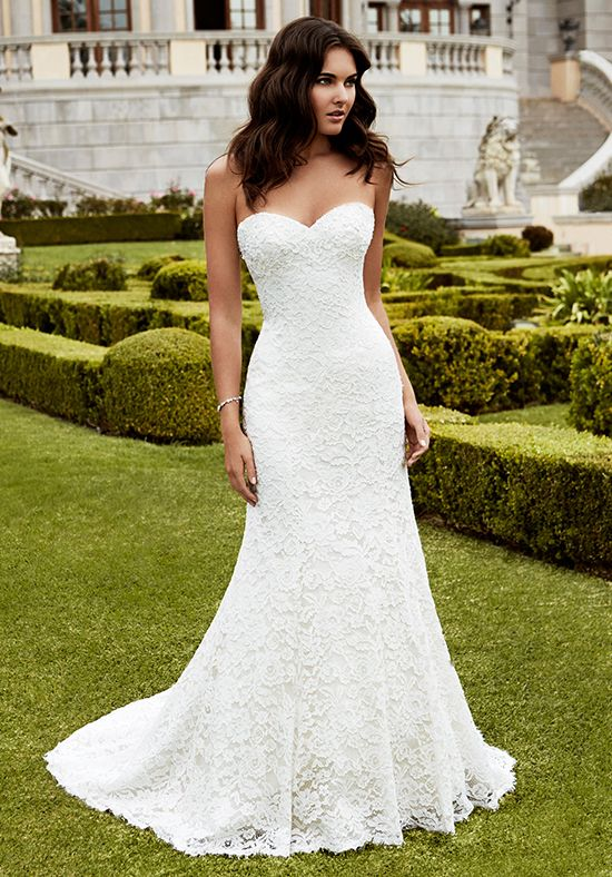 Full-length mermaid gown with a sweetheart neckline, delicate beaded appliques, and intricate corded lace overlay with scalloped hem lace. A center back zipper provides the finishing touch.