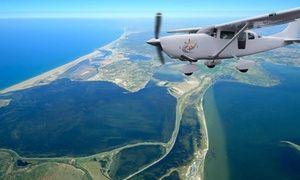 Groupon - Vol touristique chateaux cathares, cité de Carcassonne et Littoral ou stage de pilotage dès 89 € avec Skydive Flyzone à Skydive Fly zone. Prix Groupon : 89€