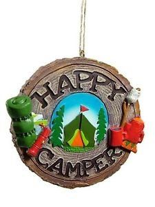 Happy Campers. WHIMSICAL ORNAMENTS: We love the character in these camping Christmas tree ornaments. With a touch of humor added to camping activities, these ornaments are bound to put a smile on everyone who sees them … even the Grinch!