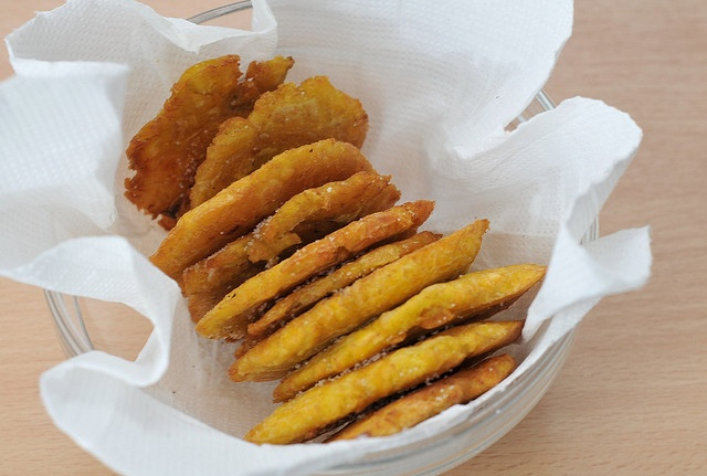 tostones -- fried plantain slices. sooo delicious with dips and toppings!