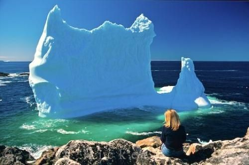 Photo of an iceberg in Notre Dame Bay in Twillingate, Newfoundland which makes iceberg watching from the shore easy.