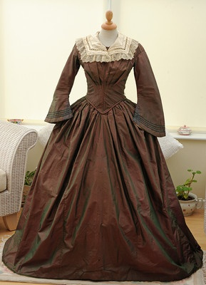 I am having a dear friend make this dress for me for the Dickens Christmas Fair.  My fabric is a narrow dark stripe, not this changeable taffeta.  I am so excited!