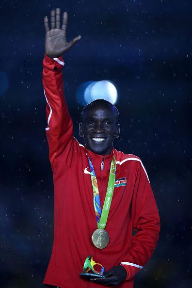 Gold medalist Eliud Kipchoge of Kenya celebrates during the medal ceremony for…