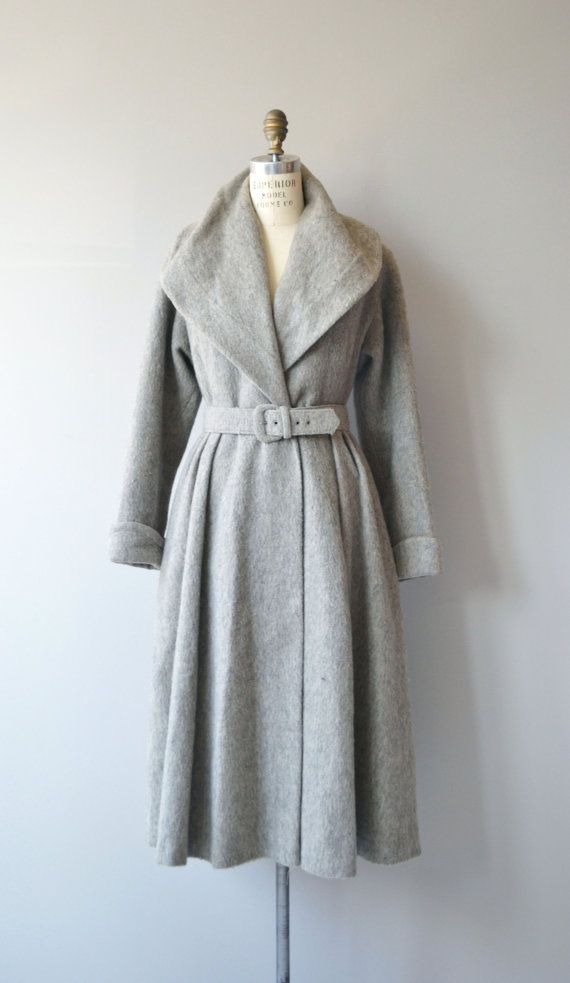 Vintage 1940s, early 1950s grey wool coat with large collar, matching belt, lovely gathered back, cuffed sleeves, pink acetate lining and hidden pockets. A heavyweight coat that is best for cold weather. --- M E A S U R E M E N T S ---  fits like: small/medium shoulder: 15.5 bust: up to 38 waist: 31 & under hip: free sleeve: 23.5 cuffed length: 46 brand/maker: n/a condition: excellent  ★ layaway is available for this item  ➸ More vintage coats http://www.etsy.com&...