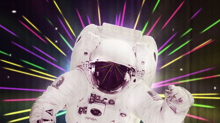 Retro Spaceman in Lights and Lazers Wallpaper