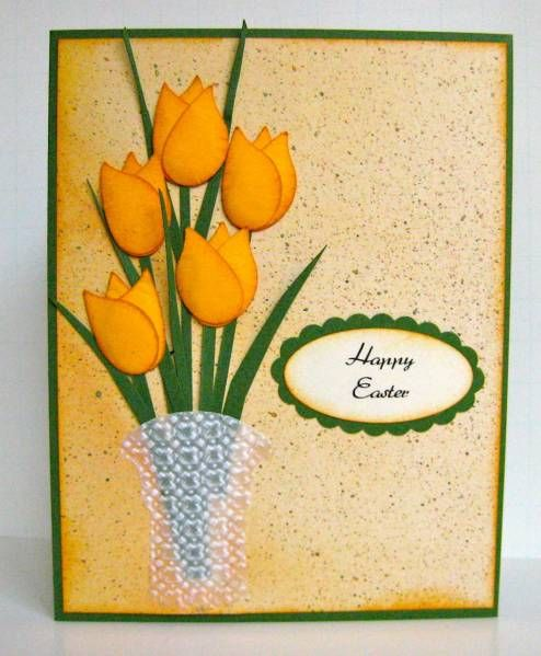 Sweet Irene  Paper: Stampin Up Garden Green and More Mustard. Vellum and unknown dp.  Tulip petals are made with the SU Bird Builder punch. Leaves and stems are hand cut.  Vase was cut with the SU Tag punch then cut and run through the Lattice embossing folder.  Sentiment is computer generated and cut out with the Oval punch and Scalloped Oval punch.