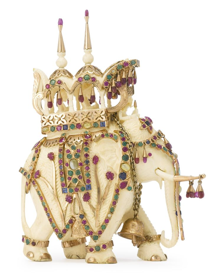 An INDIAN CARVED IVORY ELEPHANT MOUNTED IN GOLD AND JEWELS, retailed by Van Cleef & Arpels, New York, 20th century | Lot | Sotheby's