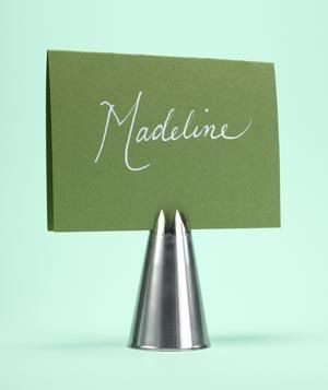 Set a sweet table and use scalloped pastry tips in fun colors as place-card holders.