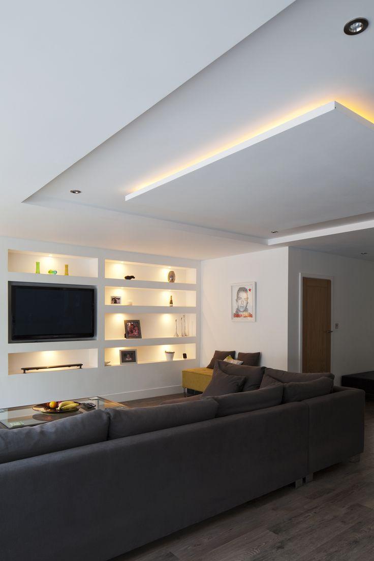 Modern Lounge | snug | seating | contemporary open plan living | huge corner sofa | built in wall shelving | TV wall | ceiling lighting |