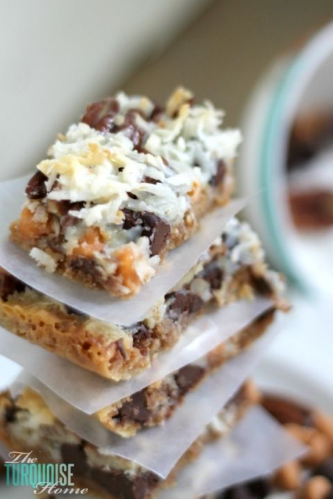 This quick and easy dessert is the traditional and yummy Hello Dolly Bar, but can also be called a Magic Bar or a 7 Layer Bar. Whatever you call it, the soft, delicious graham cracker crust, rich chocolate and crunchy coconut drizzled with sweetened condensed milk is so scrumptious that you'll be making them for every pool party this summer. | Recipe via TheTurquoiseHome.com