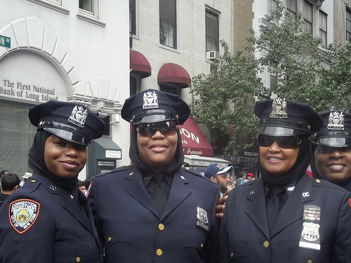 These ladies let me take their photo...they were proud to wear hijab under their uniform cap