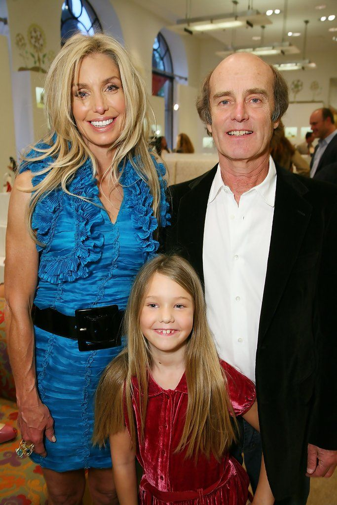 "Heather Thomas and Skip Brittenham Photos - Actress Heather Thomas with husband Skip Brittenham and daughter India pose at her Launch Party for Heather Thomas' Debut Novel ""Trophies"" at Barney's in Beverly Hills on May 6, 2008. - Launch Party For Heather Thomas' Debut Novel ""Trophies"""