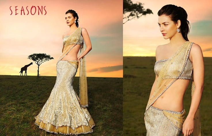 White & gold. It's so beautiful I love there collection ♥  Hindu / indian bride Wear saree, lehenga, choli from seasonsindia. the model is Neha Dalvi or maria sokolovski