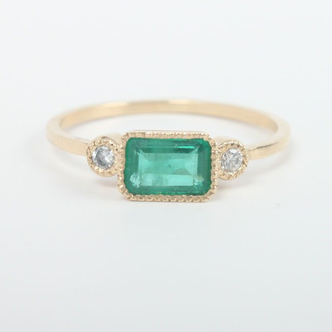 """Lexie"" emerald engagement ring with 2 3-point diamonds set in 14k yellow gold, $980, Jennie Kwon available at Catbird"