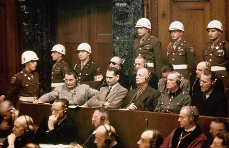 The defendants at the Nuremberg trials. Front row (l to r): Hermann Goering, Rudolf Hess, Joachim Von Ribbentrop, Wilhelm Keitel and Ernst Kaltenbrunner. Back row (l tor): Karl Doenitz, Erich Raeder, Baldur von Schirach and Fritz Sauckel.