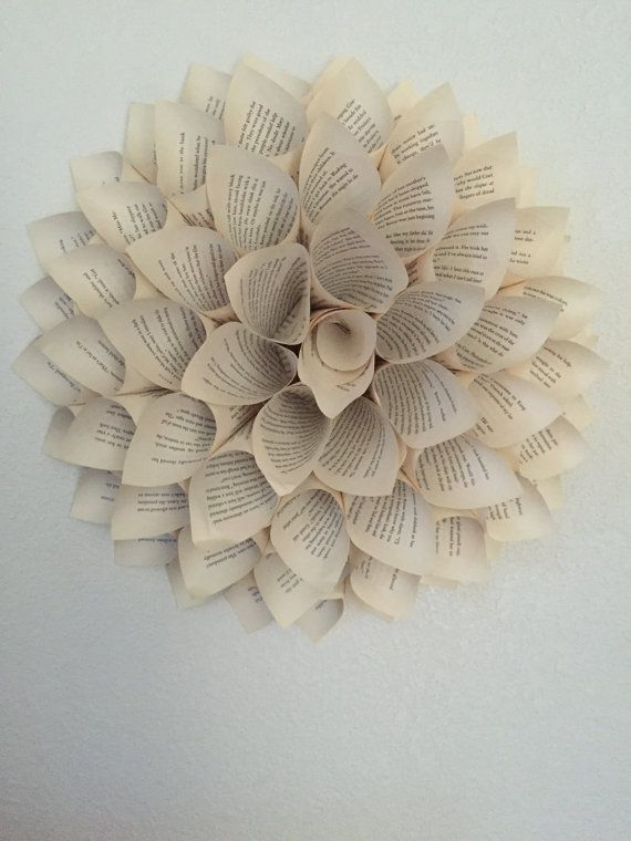 Handmade paper flowers made from book pages. This listing is for a set of 4 paper dahlias. Each are approximately 16 inches in diameter.  Please