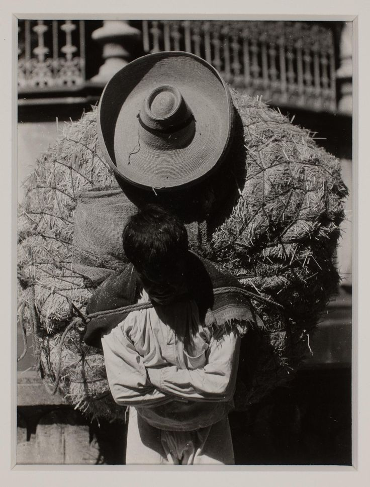TINA MODOTTI Italian, 1896–1942 Man with large load on back ca. 1925 Gelatin silver print Image: 9.6 × 7.3 cm (3 3/4 × 2 7/8 in.) Matted: 35.6 × 30.5 × 0.3 cm (14 × 12 × 1/8 in.)