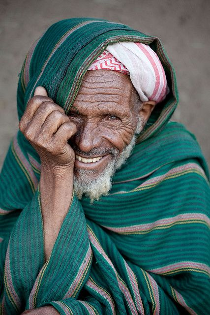 * *  A smiling elderly muslin man in Dinsho, a small village in the Bale Mountains, Ethiopia. Photographer Robin Moore.