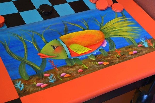 A hand painted game table and chairs, complete with checkers. Find it at wwwmissadelines.com