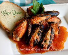 Cozze ripiene al sugo ricetta pugliese,gustoso e prelibato secondo piatto o antipasto.La ricetta della cozze ripieneè facile.Basta un po' di pane raffermo