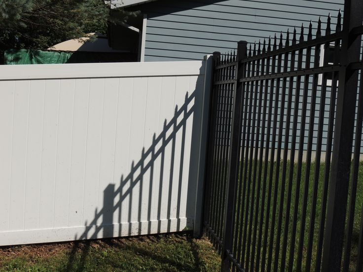 White Vinyl Privacy Fence Mixed With 6 High Spear Top