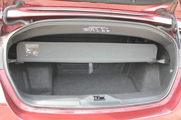 """f you want this much rear seat legroom in a convertible, you'll need to scrounge up $450,000 for a Rolls-Royce Phantom Drophead Coupe or search eBay for a '62 Lincoln Continental. The trunk is also relatively enormous, swallowing a vacation's worth of luggage even with the roof down. Countless drivers will enjoy that """"commanding"""" view of the road that's been a selling point of SUVs for the better part of two decades."""