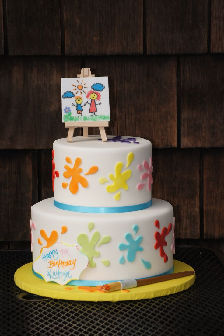 Tiered fondant covered colorful paint splatter cake