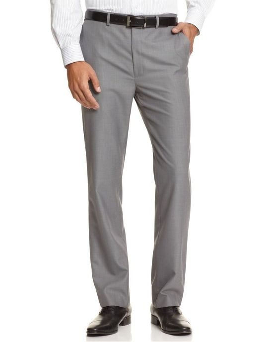 Sleek and sophisticated, these sharkskin flat front dress pants from Calvin Klein offers an extra helping of modern polish during the workweek. - Buttoned zipper fly; belt loops - Side pockets - Flat