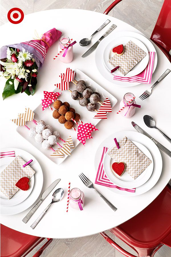 Cupid's arrows made out of Spritz straws and flags are the perfect way to serve up Valentine's Day donut holes. And extra details, like gifts on each plate and strawberry milk, also help show the love.