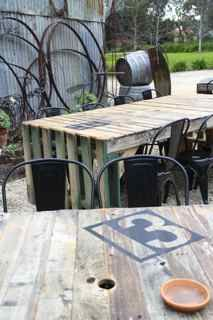 recycled pellet tables in cattle yard.