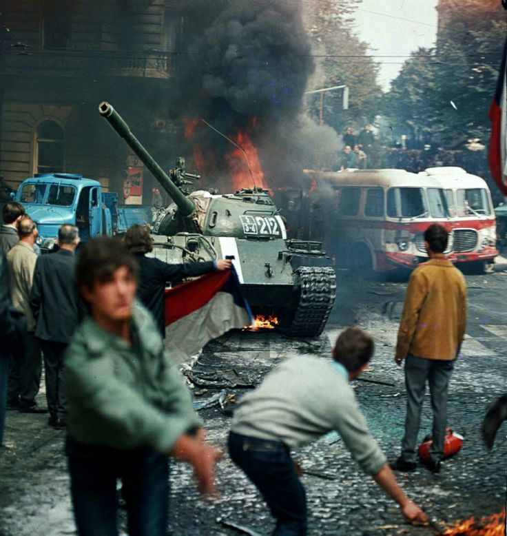 Prague residents throw burning torches at a Soviet tank during the Prague Spring, 1968