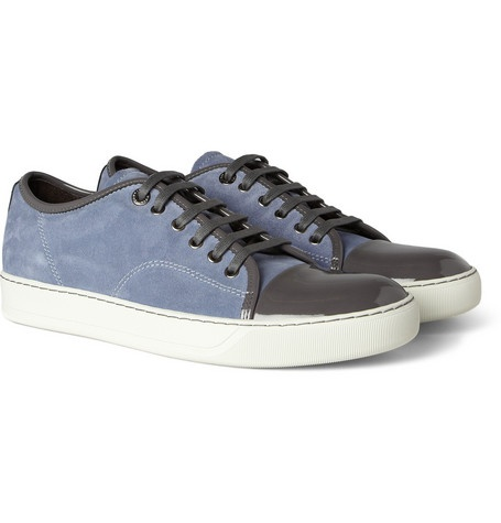 Elegantly crafted from soft suede and finished with sleek patent-leather  trims, these Lanvin sneakers make a refined footwear choice.