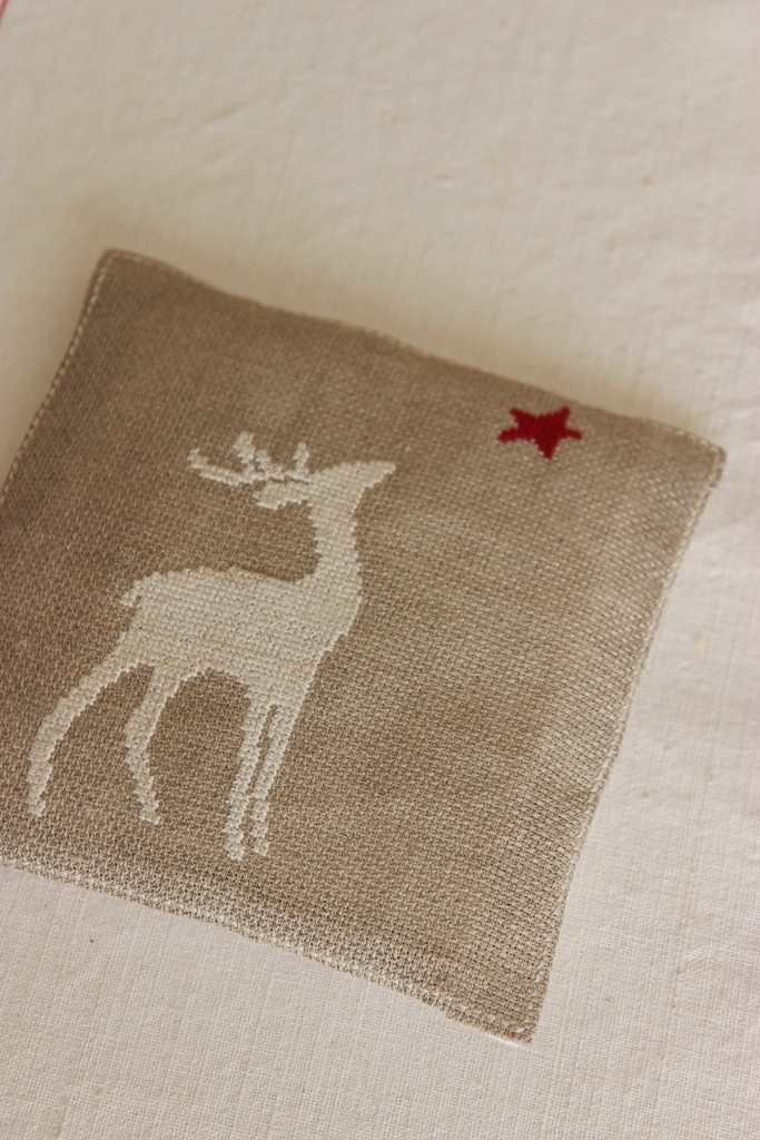 I love this reindeer design. Nice country chic Christmas design. This is done with needle point but I would use the Cricut to cut  the deer and star out of burlap.