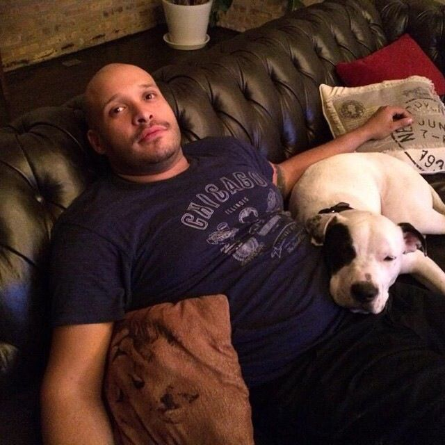 Chicago Fire star Joe Minoso relaxing in his house with his pet dog