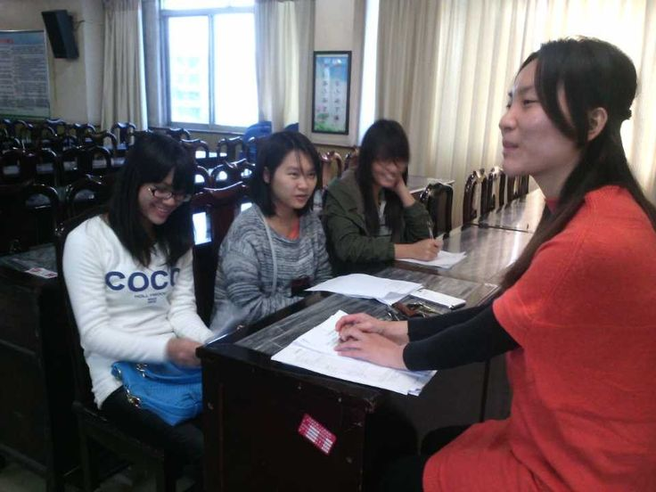 Guo Lunmin, in the red shirt, needs $100 more since she lost one sponsor.