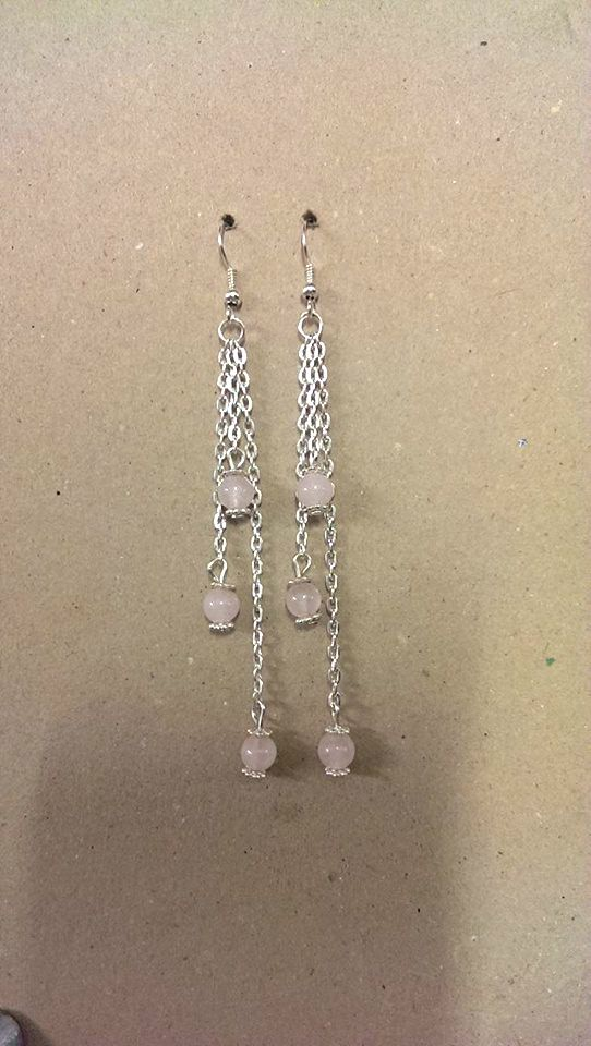 A pair of  Rose Quartz Gemstone Earrings with chain and daisy spacer beads.