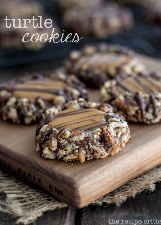 Turtle Cookies at http://therecipecritic.com Amazing chocolate cookies coated in pecans and filled with caramel! Perfection!